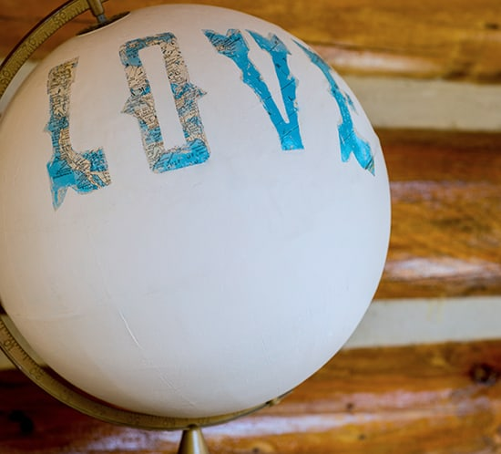 diy painted globe for wedding guestbook table decor mountainmodernlife.com