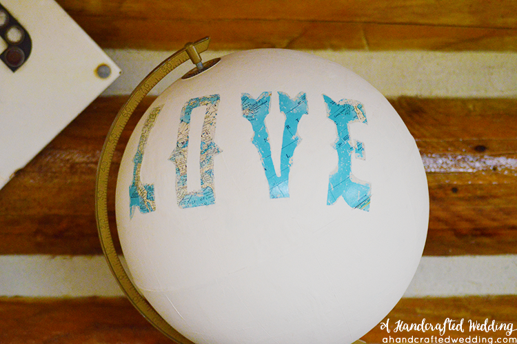 Looking for an outside the box idea? Look no further, check out this DIY Painted Globe for home or wedding decor. MountainModernLife.com