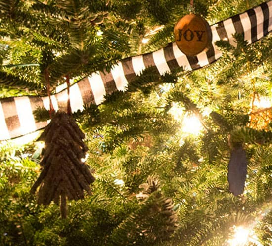 diy rustic twig christmas tree ornament on tree mountainmodernlife.com