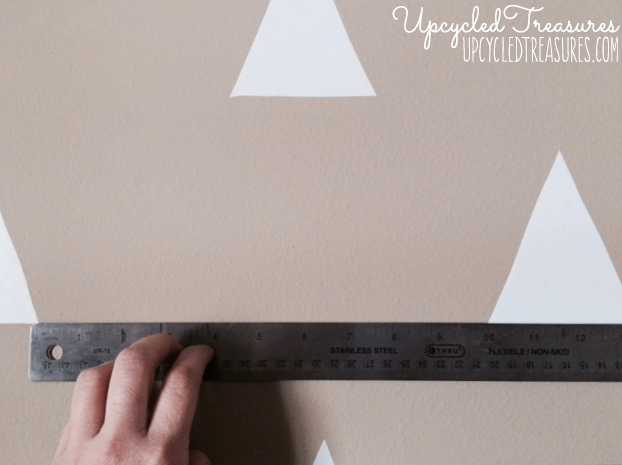 Looking to spruce up your walls in a rental property? Check out how to create a temporary DIY triangle accent wall for Less than $3! UpcycledTreasures.com