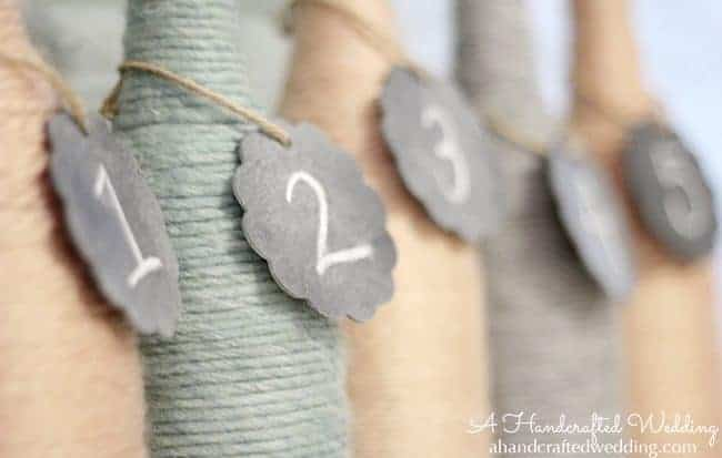 Check out how to upcycle bottles into Yarn Wrapped Bottle Vases or Table Numbers for your Wedding Reception Decor | MountainModernLife.com