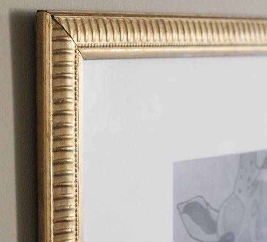 gold rubnbuff frame with giraffe print mounatinmodernlife.com