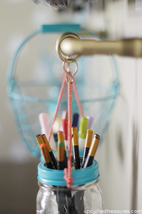 Get organized with this DIY Gold Pipe Hanging Storage which is perfect for storing items in a small space, craft room or kitchen!