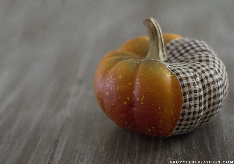 Create these adorable DIY fabric tape pumpkins by wrapping faux pumpkins with fabric tape for a rustic touch. MountainModernLife.com