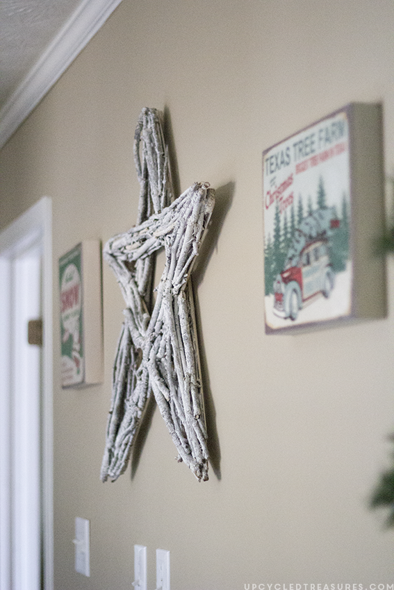 diy-twig-star-and-vintage-style-prints-on-wall-rustic-christmas-home-tour-upcycledtreasures