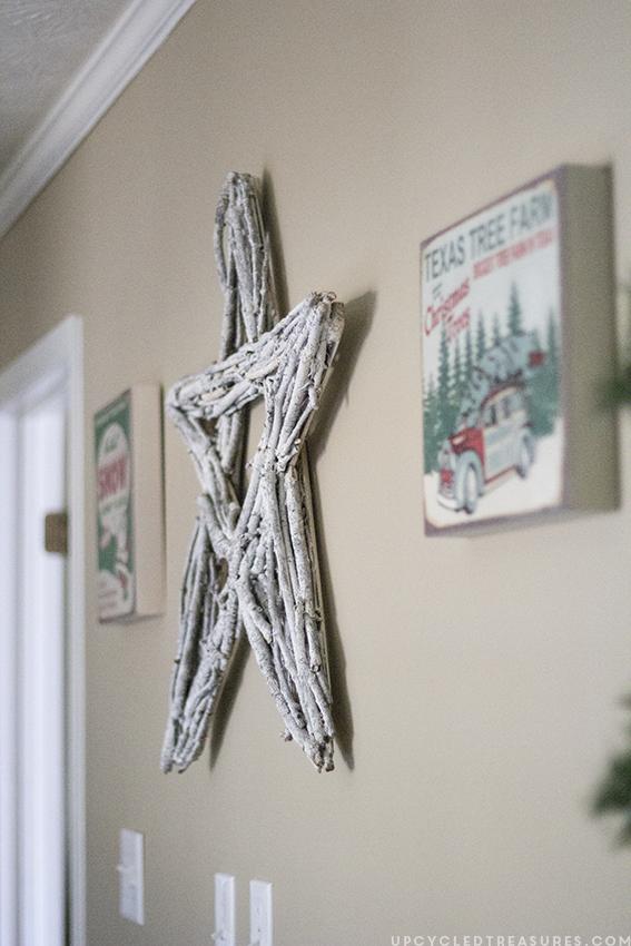 diy-twig-star-and-vintage-style-prints-on-wall-rustic-christmas-home-tour-upcycledtreasures