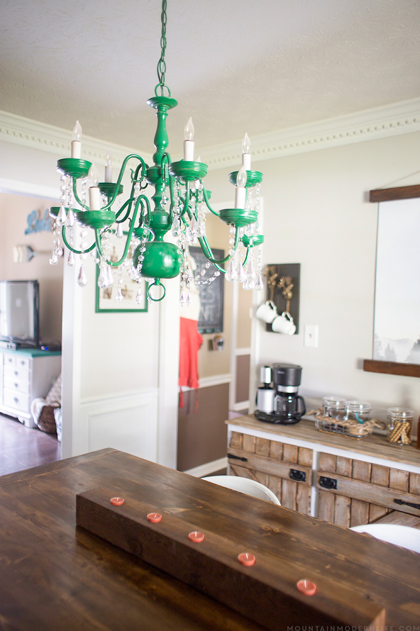 See how easy it is to create a vintage-inspired chandelier from a thrifted light fixture using spray paint and acrylic crystals! mountainmodernlife.com