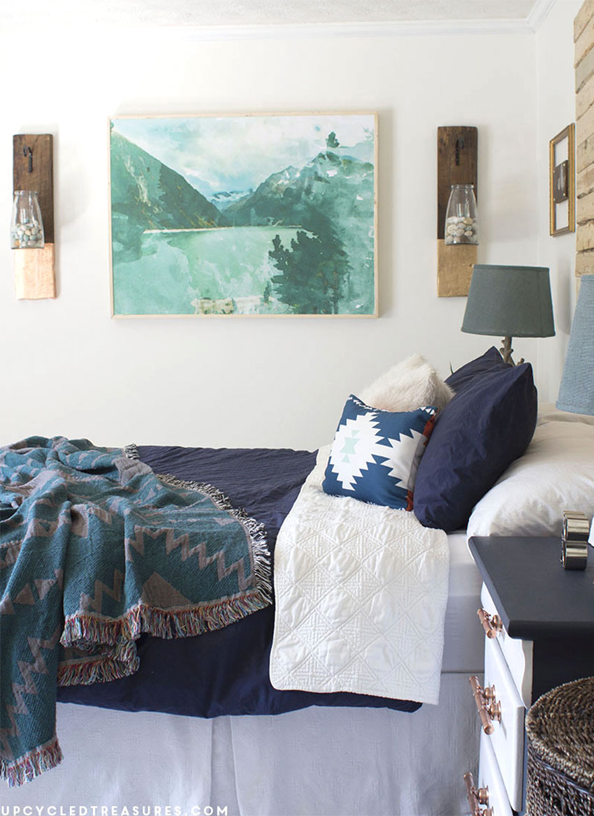 navy and white nightstands with copper pipe drawer pulls shown in bedroom. MountainModernlife.com