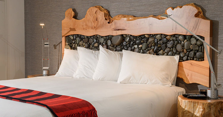 DIY Rustic Headboard with wood and river rocks | upcycledtreasures.com