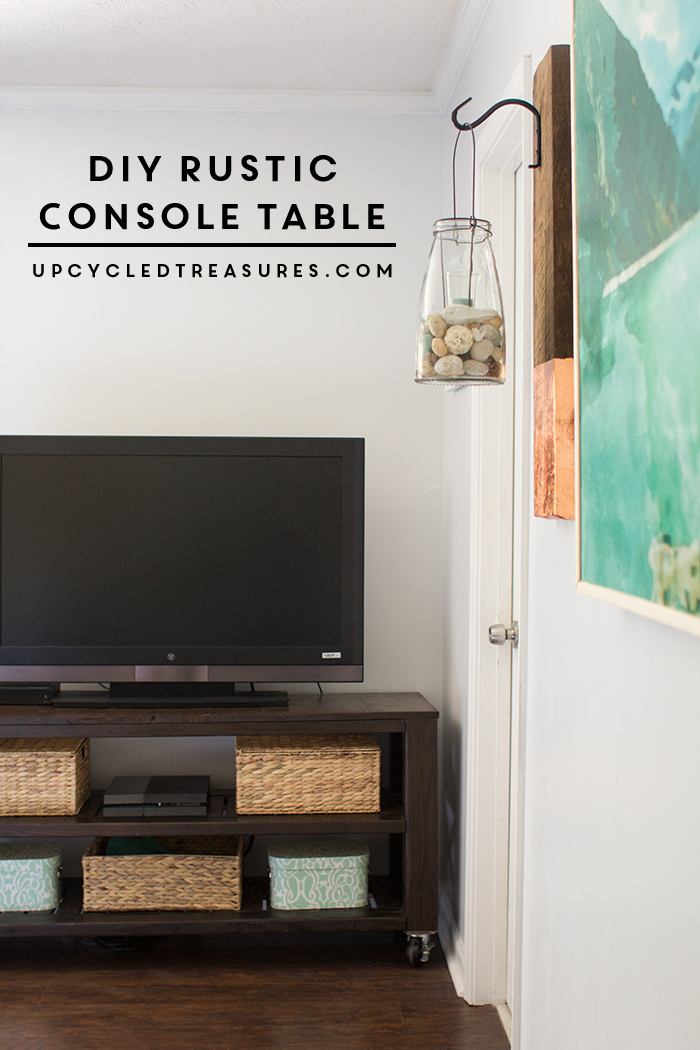 This DIY rustic console table is the perfect storage solution that doubles as a TV stand in this modern rustic bedroom. UpcycledTreasures.com