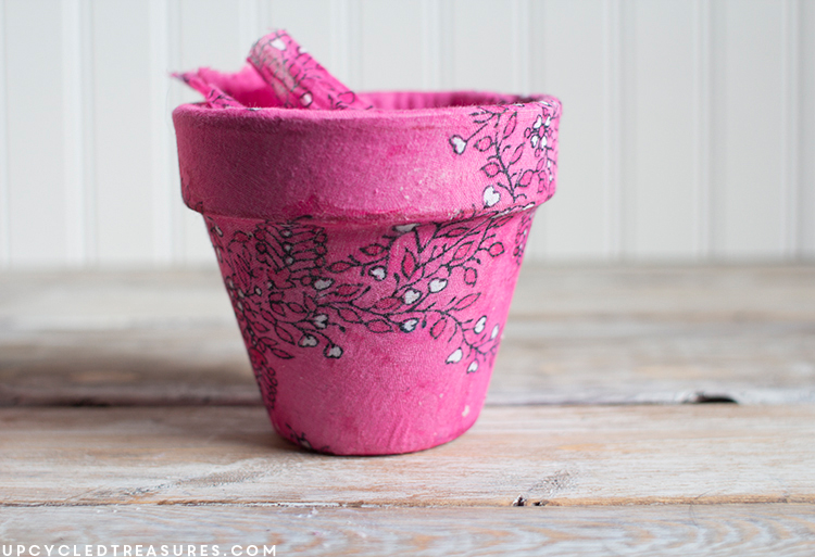 Old planter covered with pink flower designed scarf. MountainModernLife.com