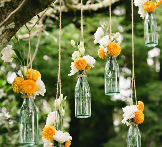 orange-dahlias-in-hanging-vases