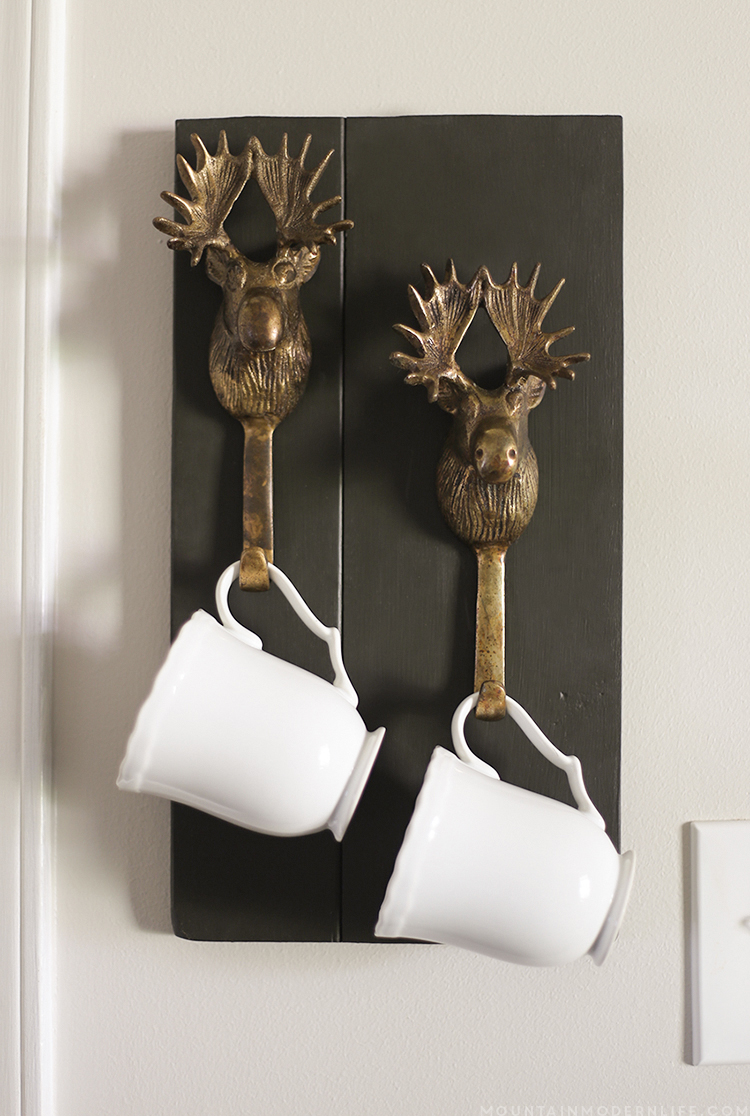 See how easy it is to make this rustic mug holder using moose hooks, perfect for a coffee bar! MountainModernLife.com