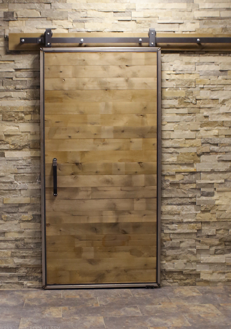sliding-barn-door-using-rustic-style-flooring-FloorAndDecor-mountainmodernlife.com