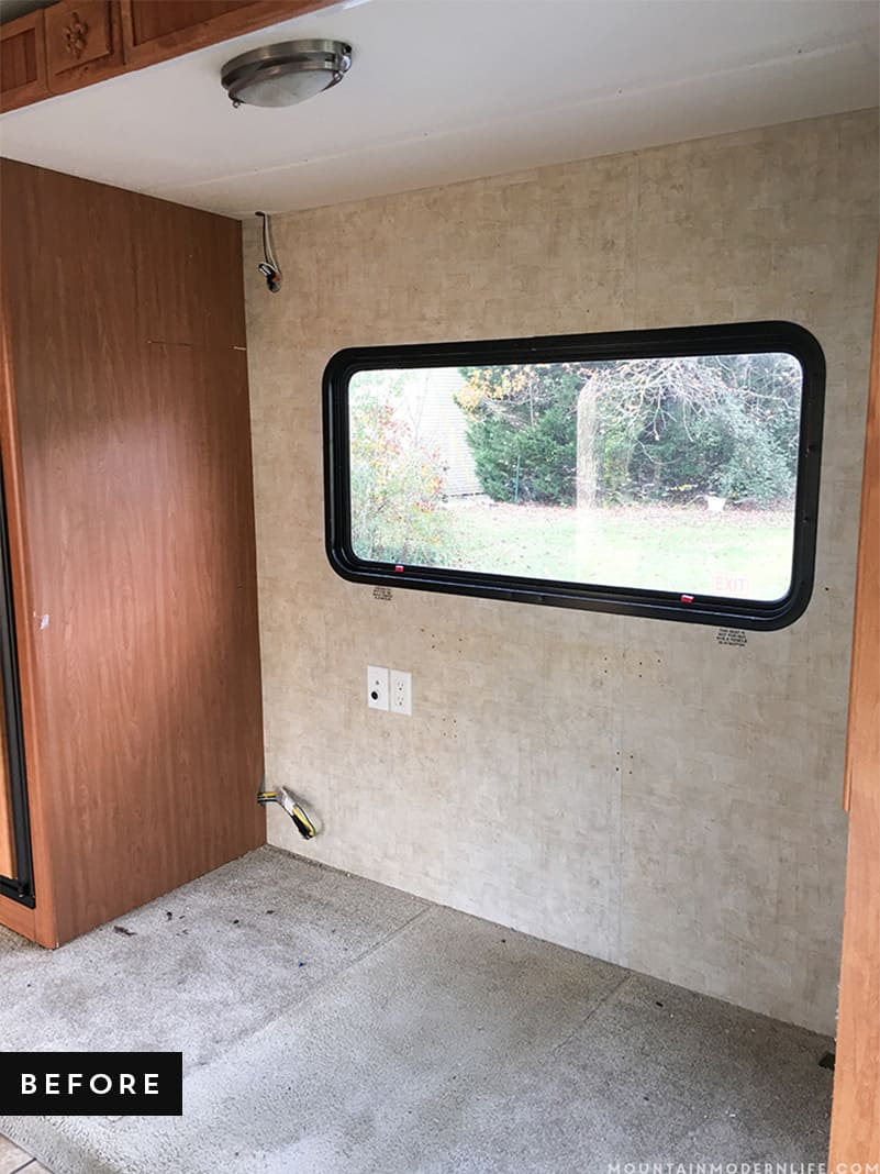 RV Slide Out with boring carpet before we installed planked flooring | MountainModernLife.com