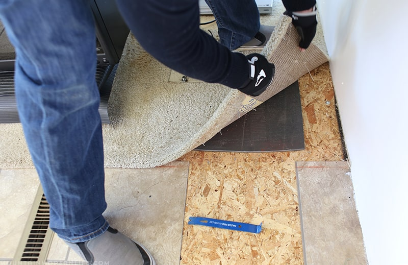 Removing the RV flooring around captain's chairs for new floor installation | MountainModernLife.com