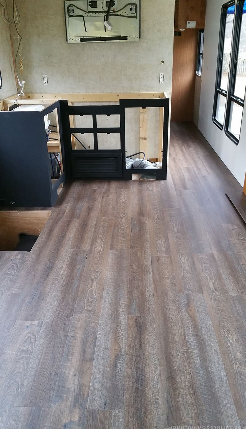 Are you looking to replace your RV flooring? Check out how we did just that in our motorhome to give it a more rustic modern vibe. | MountainModernLife.com