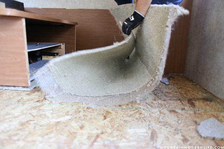 Removing the carpet inside the bedroom of the RV | MountainModernLife.com