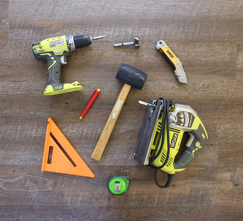 Tools used to install flooring inside RV | MountainModernLife.com