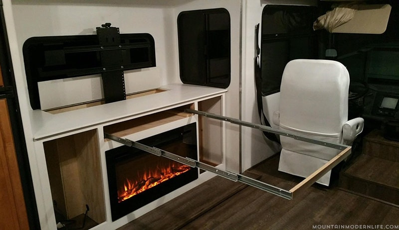 Are you considering tweaking the floor plan of your motorhome? Come see how we're installing a TV lift & electric fireplace in a custom cabinet of our RV! MountainModernLife.com