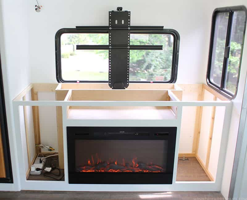 tv lift and fireplace in RV