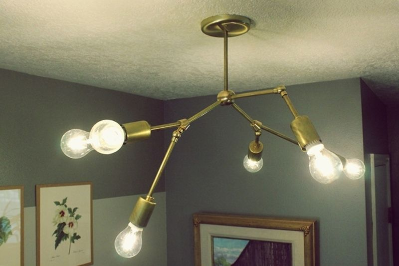 Thinking about making your own light fixture? You've gotta check out these DIY Modern Light Fixtures you won't believe are handmade! Photo: DIY Modern Brass Chandelier from HomeDit