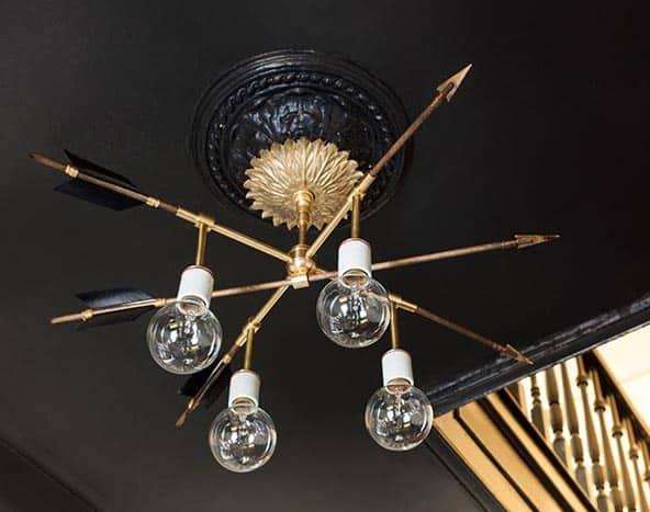 Thinking about making your own light fixture? You've gotta check out these DIY Modern Light Fixtures you won't believe are handmade! Photo: DIY Modern Brass Arrow Light Fixture from DesignSponge