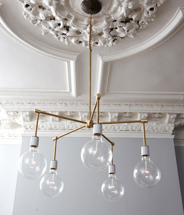 Thinking about making your own light fixture? You've gotta check out these DIY Modern Light Fixtures you won't believe are handmade! Photo: Modern Brass Chandelier from One King's Lane