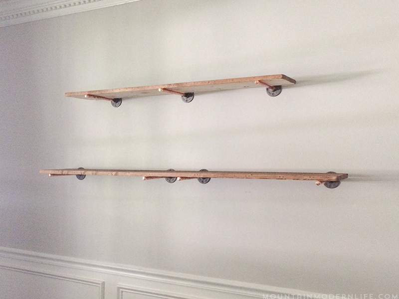 Looking to create shelves with little to no tools? See how you can easily create these Rustic Modern Shelves using pipes! MountainModernLife.com