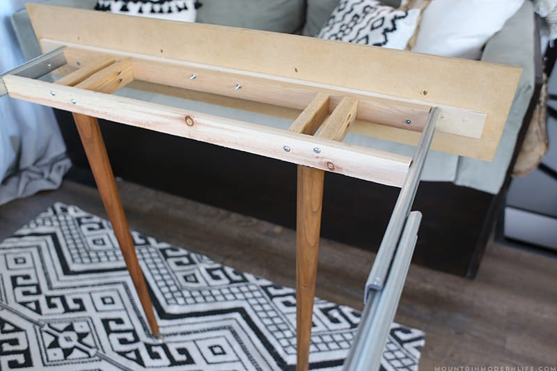 Space saving diy pull out table for Diy mountain shelf plans