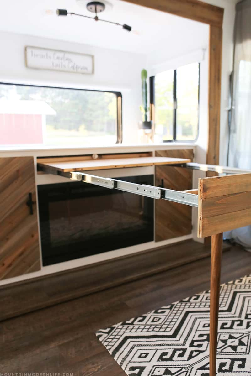 Whether you live in a small space, or are looking for space saving ideas, you've gotta check out this DIY pull out table that was built inside a RV! MountainModernLife.com