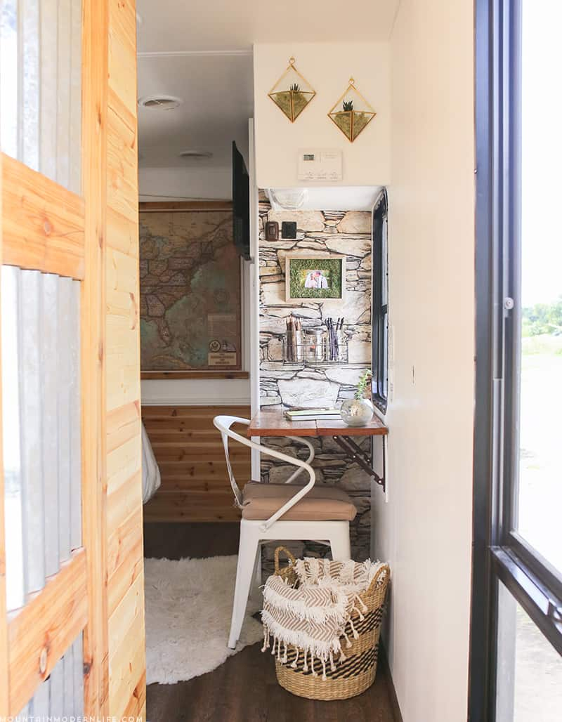 See how we added character and function to our RV by creating a wall-mounted desk from reclaimed wood. MountainModernLife.com