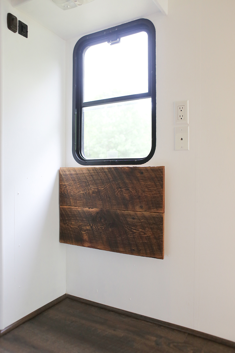 Save Space and add character to your home with a reclaimed wall-mounted desk that flips down when not in use. This is perfect for creating a workspace in an RV! MountainModernLife.com