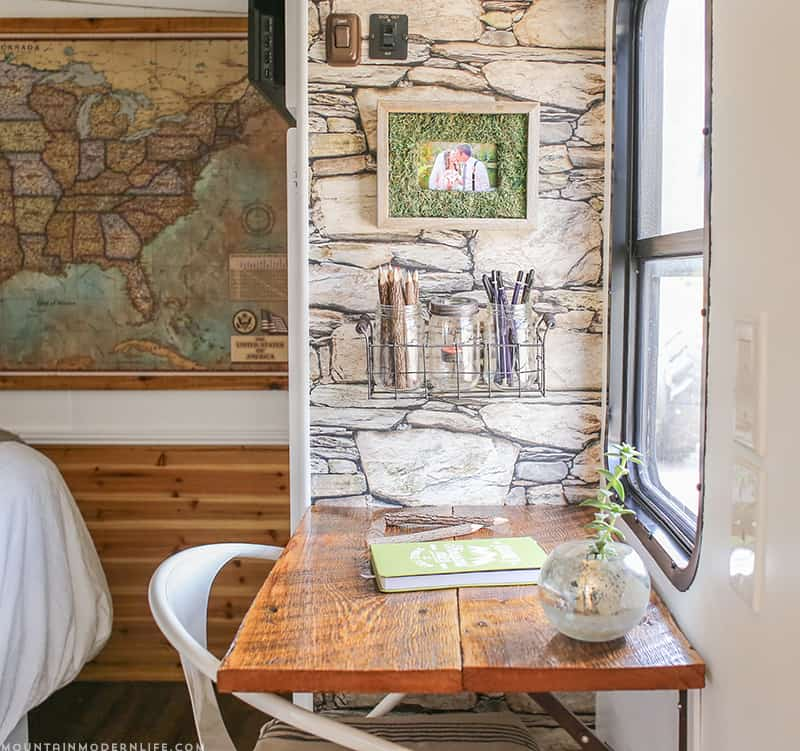 Do you rent, own a RV or just need some temporary wall decor ideas? See how you can create a rustic accent wall that you can easily remove!
