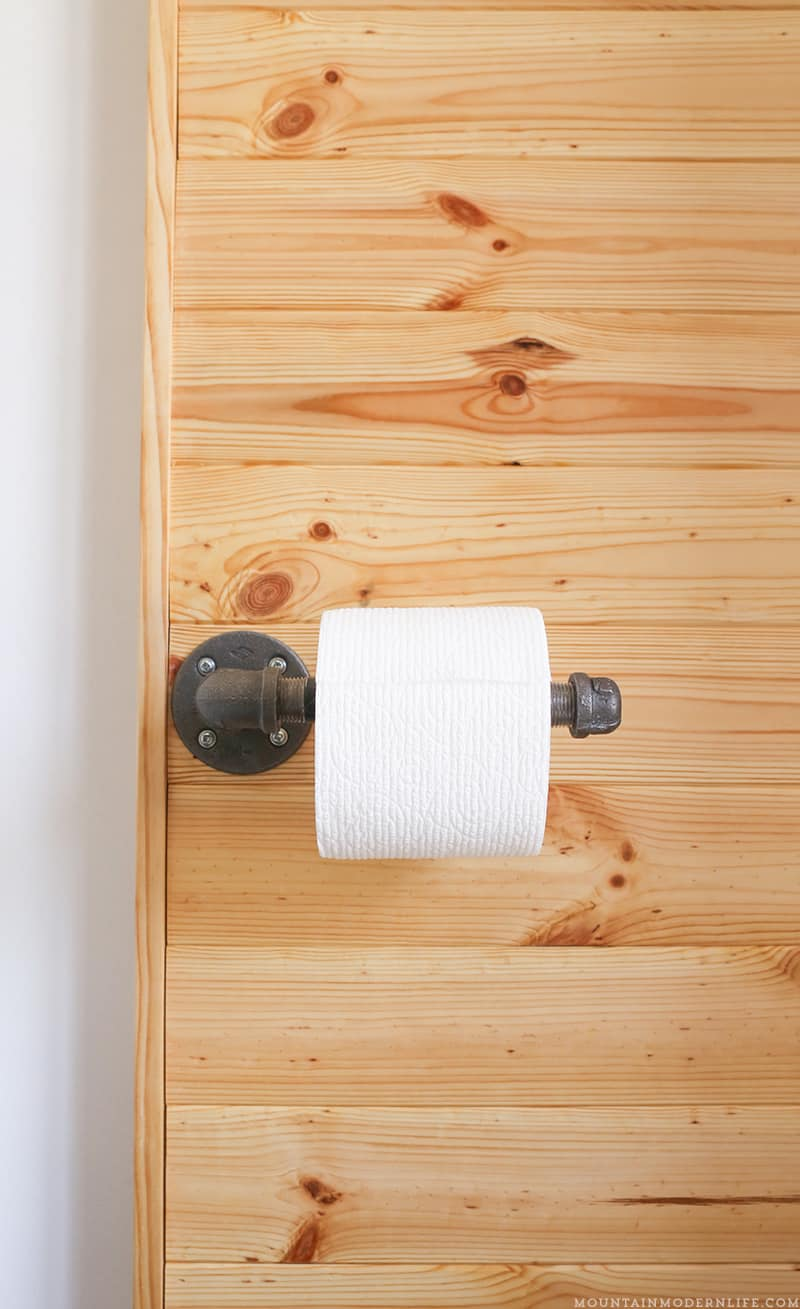 Looking to add character to your bathroom? See how you can make this rustic toilet paper holder in less than 5 minutes! MountainModernLife.com