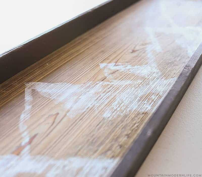 See how easy it is to create this mountain wall art using reclaimed wood. | MountainModernLife.com