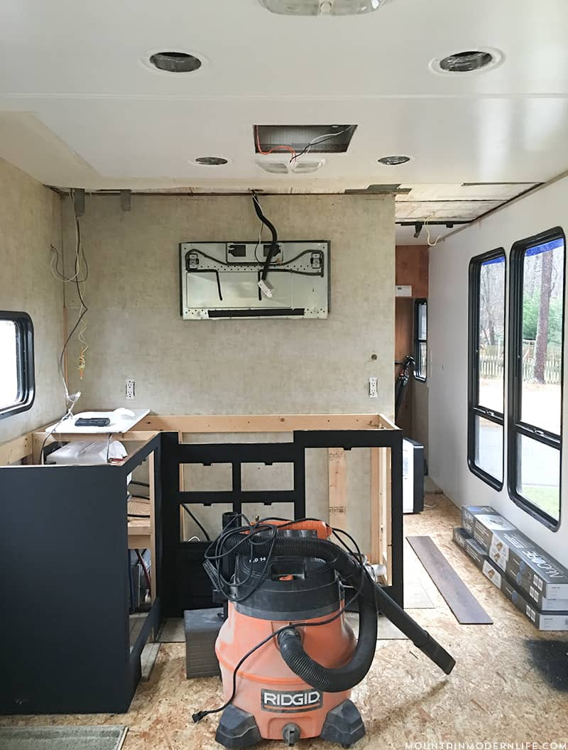 Come see how we painted our two-toned RV kitchen cabinets, and skip the mistakes I made along the way! MountainModernLife.com