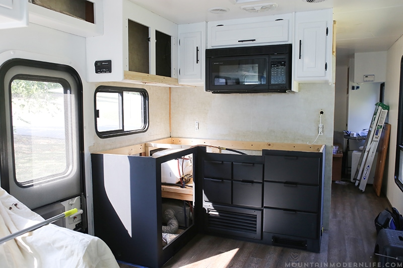 Looking for an affordable way to update your kitchen counters? Check out this post on how to Create Wood Counters from Flooring (in a RV)! MountainModernLife.com