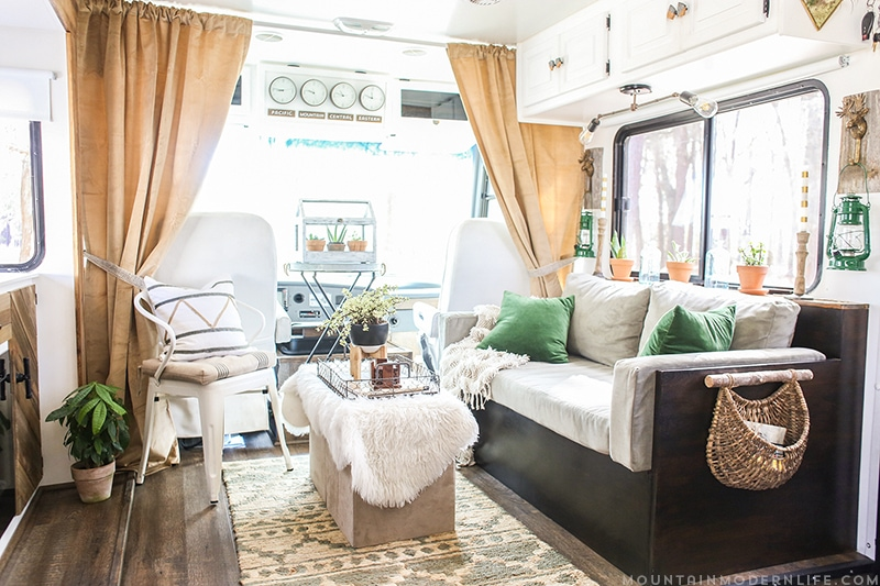 Could you live in 200 square feet? See how this outdated motorhome was completely transformed into a rustic modern RV! MountainModernLife.com