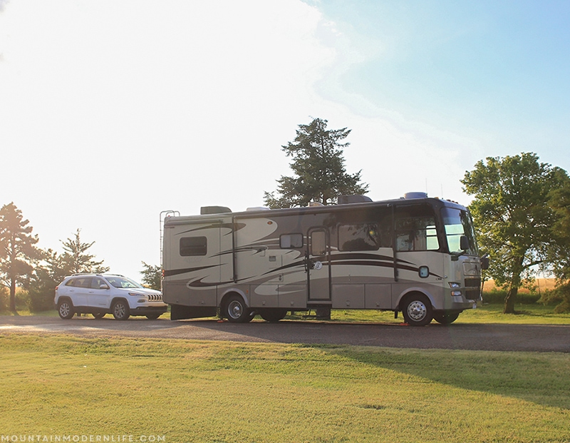 Our RV in front of the car at the Kansas rest stop | Mountainmodernlife.com