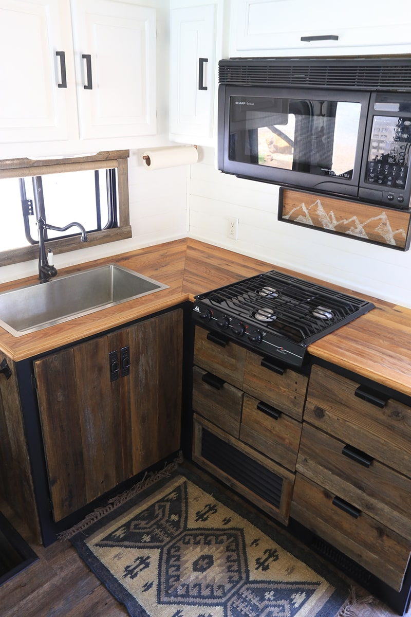 Reclaimed Wood Kitchen Cabinets inside RV | MountainModernLife.com