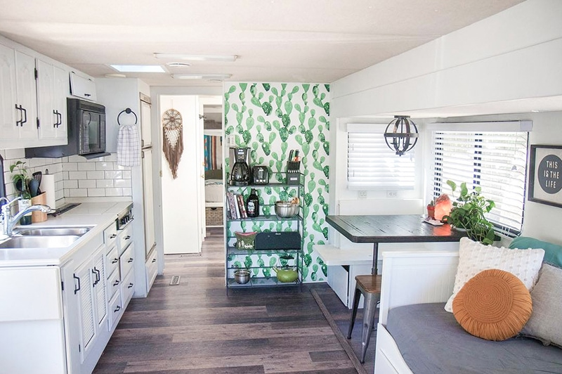 Tour this RV renovated for a family of 4 from @CaitiJackson! Featured on MountainModernLife.com