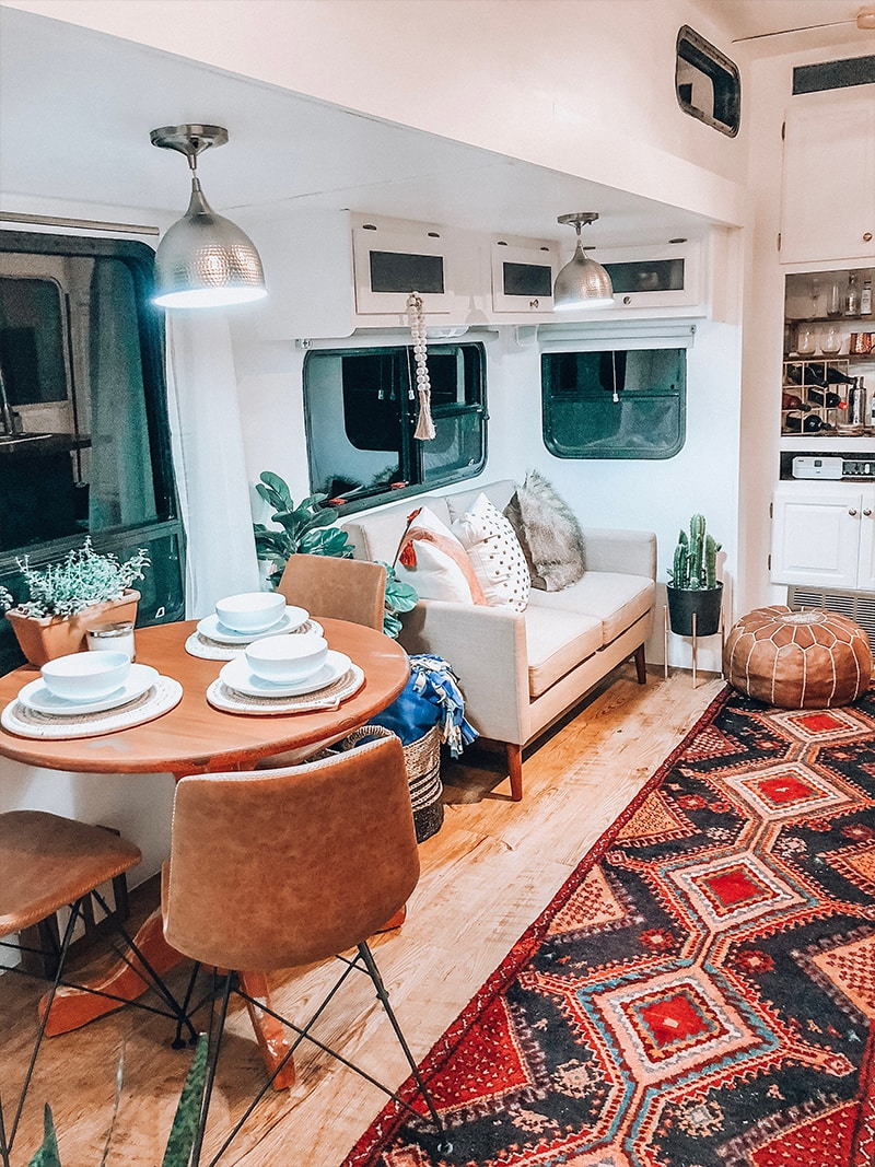 See how a passion for international travel influenced the interior design of this camper renovation! / Photos by @ems_traveldiary / Featured on MountainModernLife.com #camperrenovation