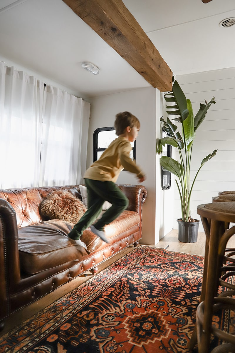 Tour this modern RV renovation with old world charm from @r.maria.fuller that has wood beams that will make you swoon! See the before and after on MountainModernLife.com