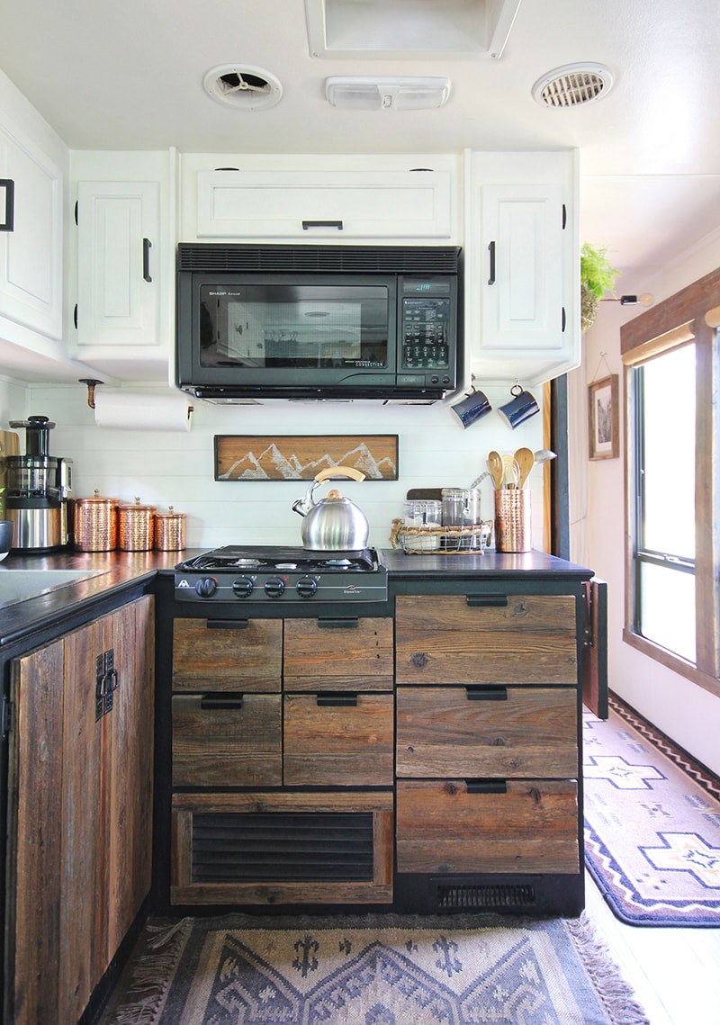 Considering adding black kitchen countertops to your home? Come see how we updated butcher block countertops for a rustic modern vibe in our RV.
