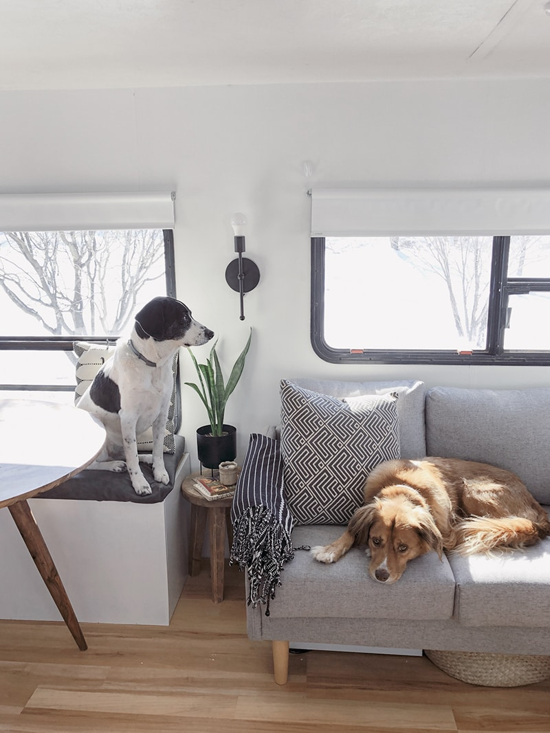 Tour this Modern RV Remodel filled with Scandinavian Coziness from Detach and Roam! Featured on MountainModernLife.com