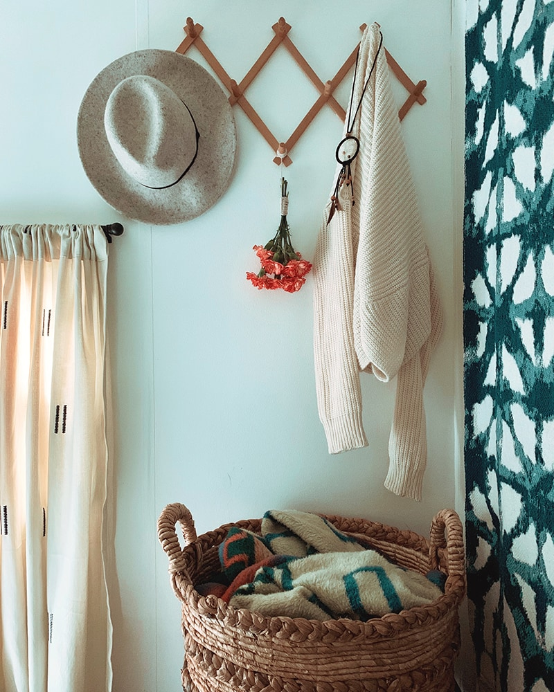 The muted earth tones in this eclectic camper will have you dreaming of the desert | Featuring @madefreeco on MountainModernLife.com