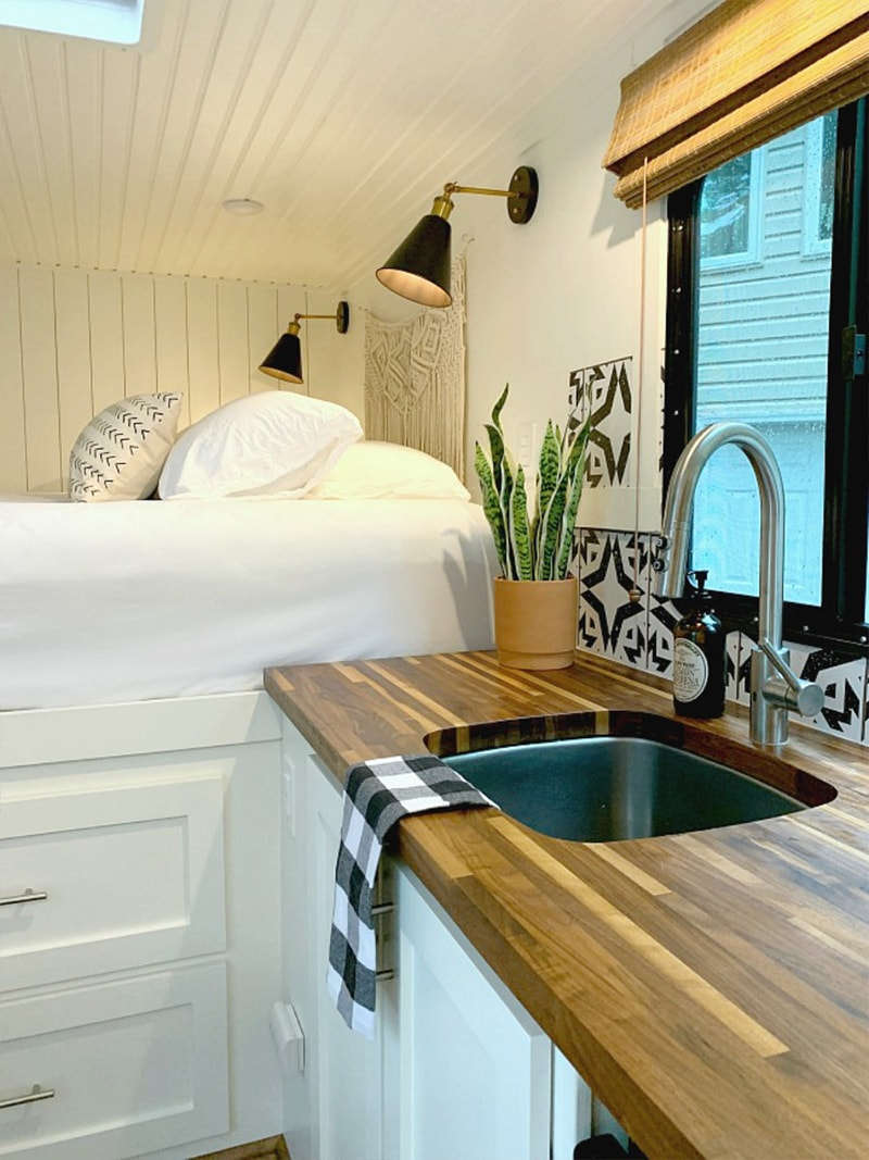 This may be the most stylish cargo trailer conversion you've ever seen! Come see how @ChatfieldCourt transformed an empty shell into a modern tiny home on wheels! Featured on MountainModernLife.com
