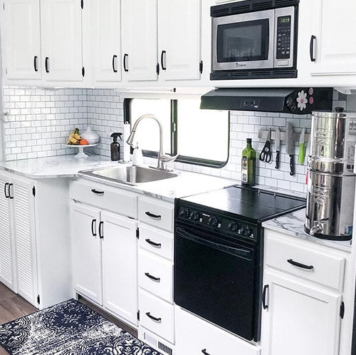 White RV Kitchen Interior from @fifthwheelfarmhouse
