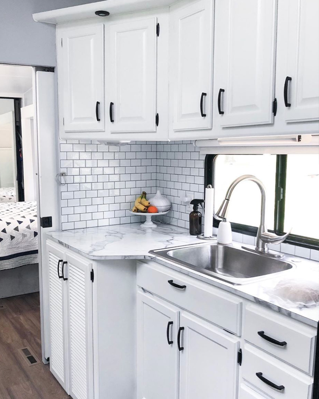 See how a white and gray interior transformed this remodeled 5th wheel!